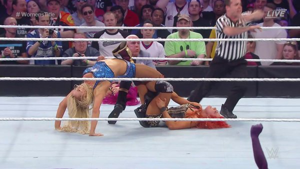 You can just see Ric with his hands on Sasha in the background - such a shameful way to end an incredible match.